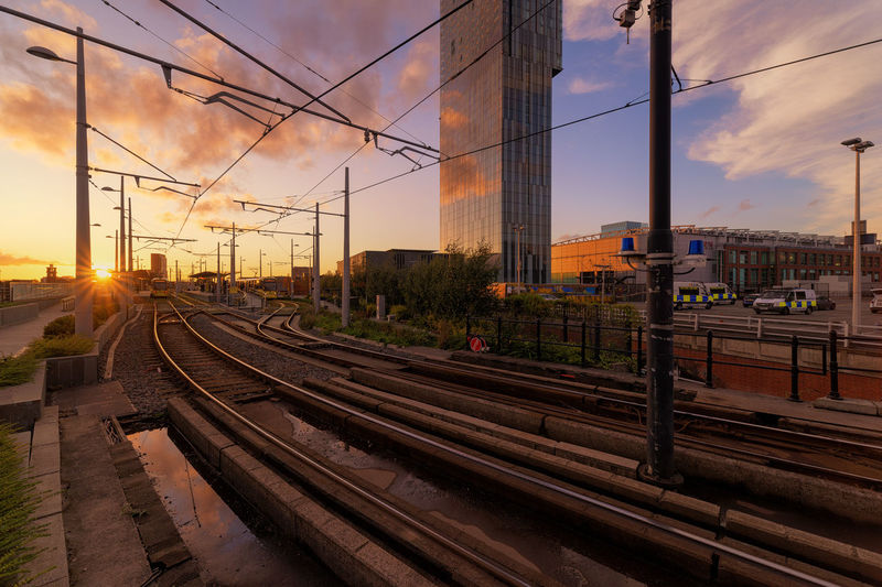 sunset spray. Railroad Track Sunset Business Finance And Industry Rail Transportation Transportation Sky Cloud - Sky City Downtown District Skyscraper Steel Electricity  Modern Architecture Urban Skyline Cityscape Paint The Town Yellow City Trains