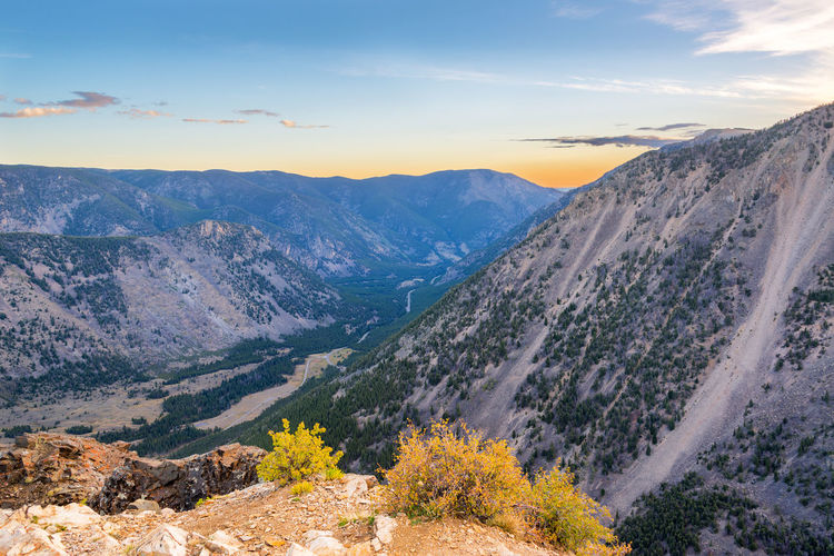 Scenic View Of Beartooth Mountains Against Sky At Yellowstone National Park