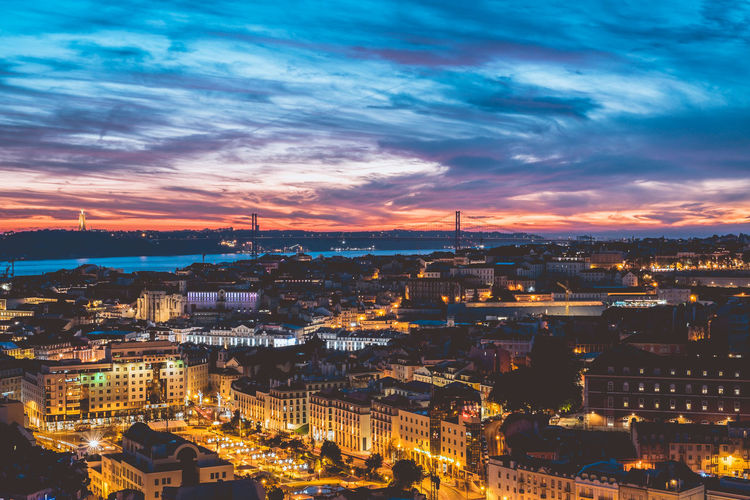 Beautiful Evening sky and the city lights of Lisbon Architecture Built Structure Travel Destinations Lisbon Portugal Europe Building Exterior City Cityscape Sky Building Cloud - Sky Illuminated Nature No People Residential District Sunset High Angle View Outdoors City Life