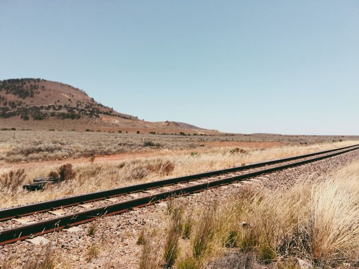 Railway Copy Space Landscape Clear Sky Transportation Tranquil Scene Non-urban Scene Scenics Blue Tranquility Field Day Outdoors Rural Scene Remote Arid Climate Nature Mountain No People Countryside Tourism Outback Australia Train Train Tracks Desert