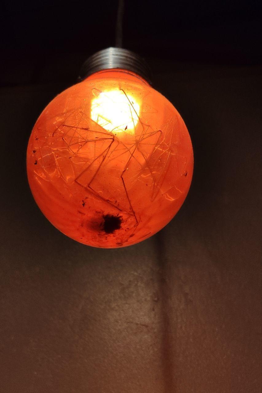 CLOSE-UP OF ILLUMINATED LIGHT BULB IN WALL