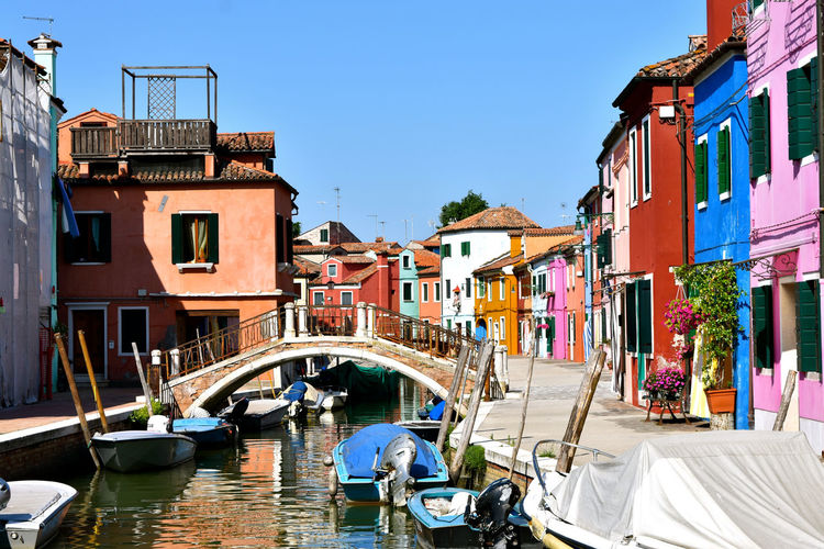 Burano, Italy Venice, Italy Architecture Building Exterior Built Structure Canal Canals And Waterways Clear Sky Day Italy Nautical Vessel Outdoors Residential Building Sky Venice Water