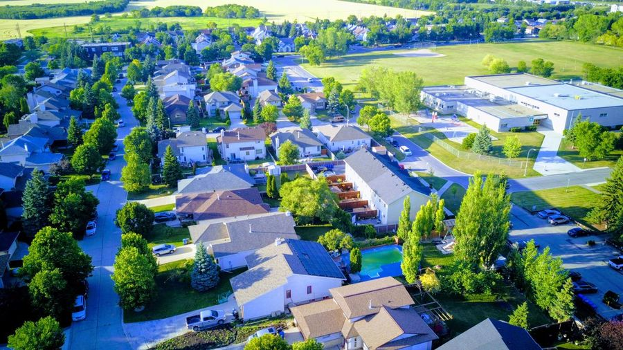 Suburbia Golden Hour Assiniboine High Angle View Plant Building Exterior Built Structure Architecture Nature Tree Building Aerial View Sky Cityscape Beauty In Nature Residential District Green Color No People Day Sunlight Outdoors City Growth
