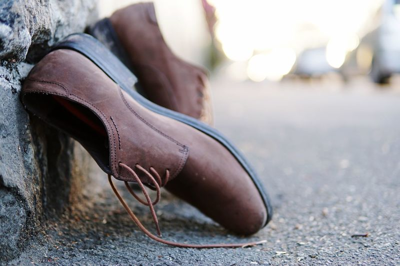 Sometimes we need to take our shoes off. Eyeem New Zealand Sony A6300 Shoe One Person Human Body Part Body Part Focus On Foreground Low Section Human Leg Close-up Day Lifestyles Fashion Shoelace Limb Outdoors Leather Brown A New Beginning