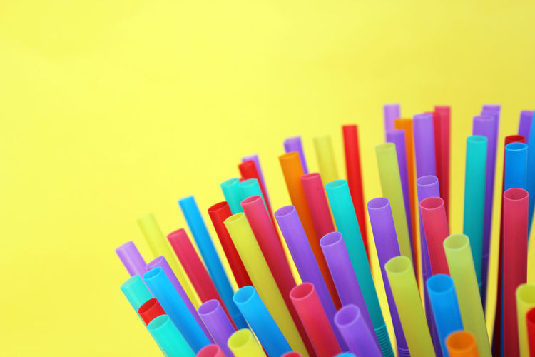 Close-up of multi colored pencils against yellow background