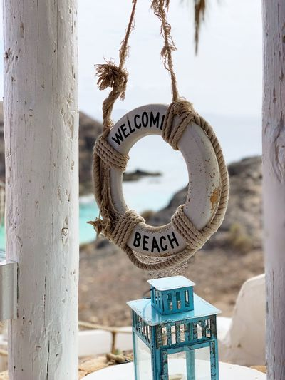 Buoy Ocean Plank Light Natural Wood Sand Sea Sun Beachphotography Beach Day No People Hanging Focus On Foreground Shape Close-up Metal