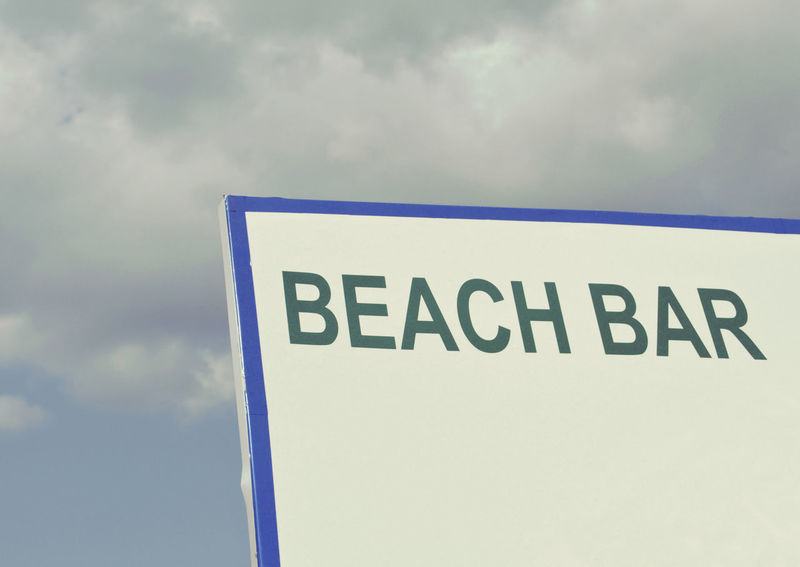 beach bar sign against cloudy sky Bar Sign Text Western Script Sky Communication Cloud - Sky No People Sign Capital Letter Day Close-up Low Angle View Information Sign Copy Space Signboard Beach Bar Advertising