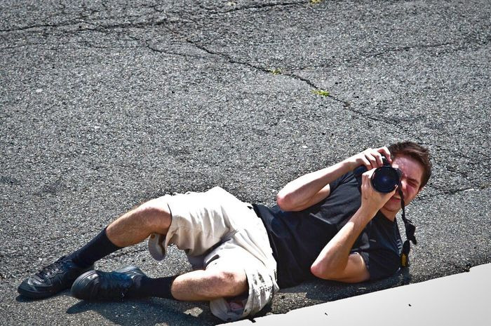 Things I Like Young Adult Mid Adult High Angle View Photographer Photographer In The Shot Taking Photos Taking Pictures Taking Photo Black Shirt Lying Down Macadam Street Lookingup Camera Teenager Man Full Length Holding Person Day Hobby Black Socks Casual Clothing EyeEm Gallery