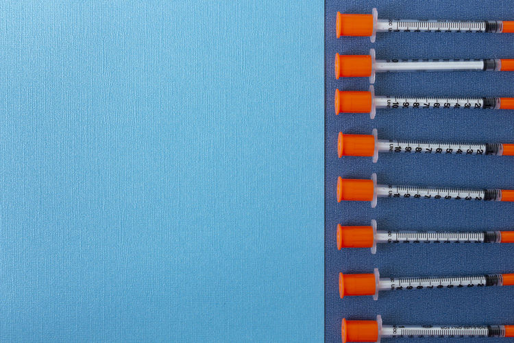 Close-up of blue wall against sky
