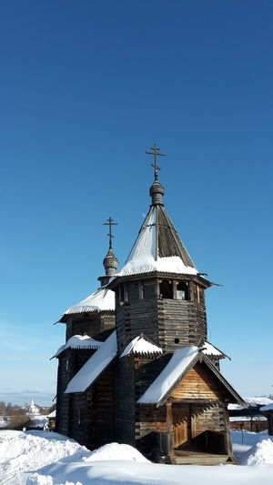 Old wooden church in the open air museum of Suzdal', Russia Snow Cold Temperature Winter Sky Architecture Built Structure Building Exterior Blue Religion Nature Spirituality Place Of Worship Day Belief Building Clear Sky Sunlight No People Outdoors Open Air Museum Church Buildings Wooden Church  Travelling Tourism Historic