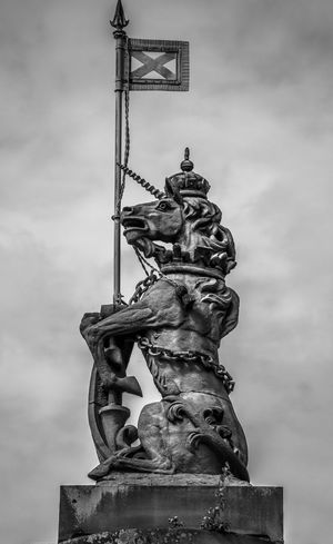 The Unicorn, from the Lion and the Unicorn on the UK Coat of Arms, standing over the entrance to Holyrood Palace, in Edinburgh. Coat Of Arms Edinburgh Great Britain Heraldic Heraldry Holyrood Holyrood Palace Lion And The Unicorn Midlothian Mono Monochrome Palace Regal Residence Royal Scotland Scottish Scottish Unicorn Statue Uk Unchain The Unicorn Unicorn