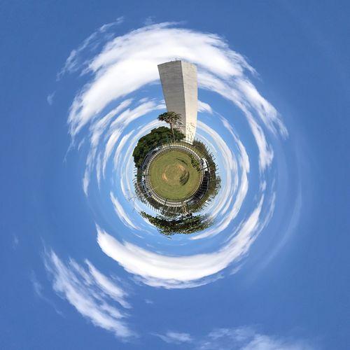 Digital composite image of building on land against sky