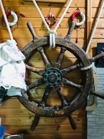 Helm Transportation No People Circle Indoors  Wood - Material Shape Metal Wheel Day Creativity Equipment Close-up Mode Of Transportation Art And Craft Hanging Geometric Shape Pattern Rope Ceiling Time
