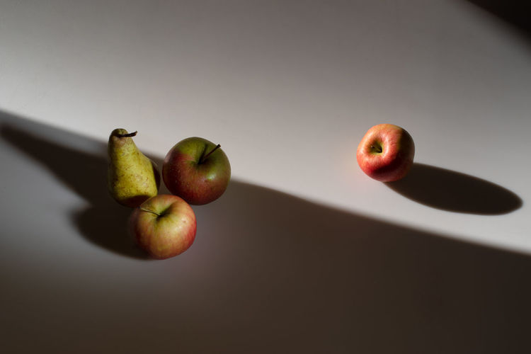 Practising with light and composition: Different Orientation Composition Apple - Fruit Copy Space Day Food Food And Drink Freshness Fruit Gray Background Group Of Objects Hard Contrast Healthy Eating Indoors  Light Table No People Pear Practise Practise Session Red Ripe Rule Of Odds Unnatural Shadows