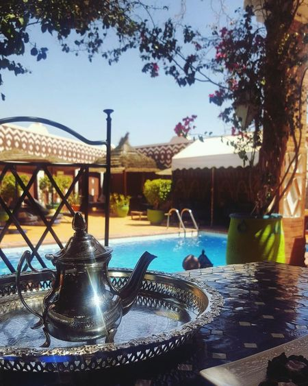 Water Fountain Swimming Pool Reflection Tree Drinking Fountain Outdoors Day No People Sky Marocaine Culture Teapot Tea - Hot Drink