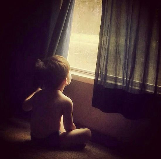 Nephew  Watching The Rain Precious Moments Photography Looking Back A Memory Captured Eye4photography  First Eyeem Photo Simplicity