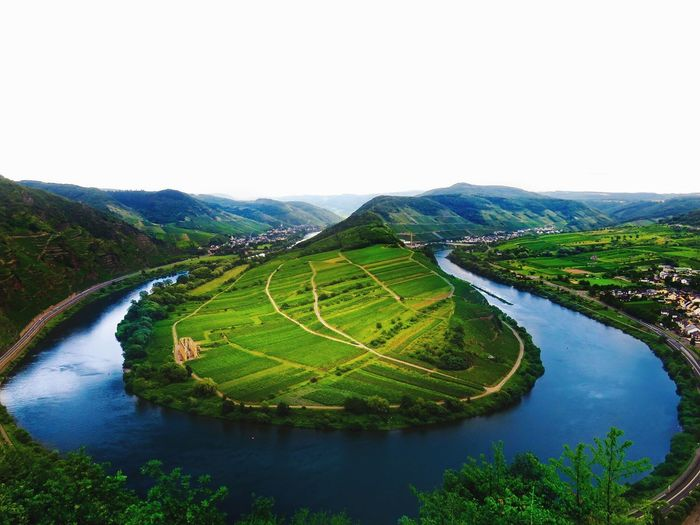 Let the river run 🏞 Water Scenics Nature Tranquil Scene Beauty In Nature Tranquility Landscape Mountain Agriculture Outdoors River No People Day High Angle View Field Green Color Rural Scene Travel Destinations Terraced Field Sky
