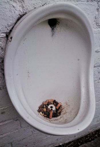 Cigarette butts in abandoned urinal