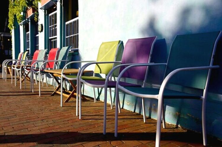 Colorful chairs. Colors Chairs Outside Outdoor Seating Wall Lined Up In A Row Multiple Urban Spring Fever
