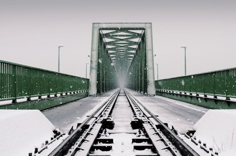 Railway bridge against clear sky during winter