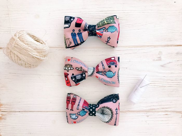 Wood - Material High Angle View Fashion No People Shoe Still Life Clothing Table Indoors  Pattern Directly Above Pair Creativity Glasses Group Of Objects Heart Shape Art And Craft Personal Accessory