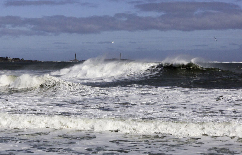 After the Strom Long Beach Storm Thatcher Island Beauty In Nature Blue Day Force Gloucester Light Houses Motion Nature No People Outdoors Power In Nature Sea Sky Twin Lights Water Wave