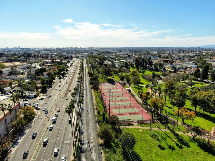 Green Dronephotography Park Palm Tree Train Tracks Railroad Track City Cityscape Tree Road Aerial View Car Land Vehicle Traffic Highway High Angle View
