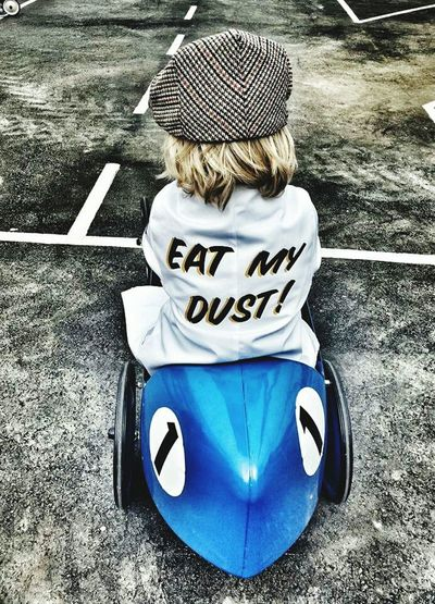 Eat My Dust Childhood Outdoors High Angle View Headwear One Person Day People Children Playing Children Car Cap Eat My Dust Child Play Blue Car