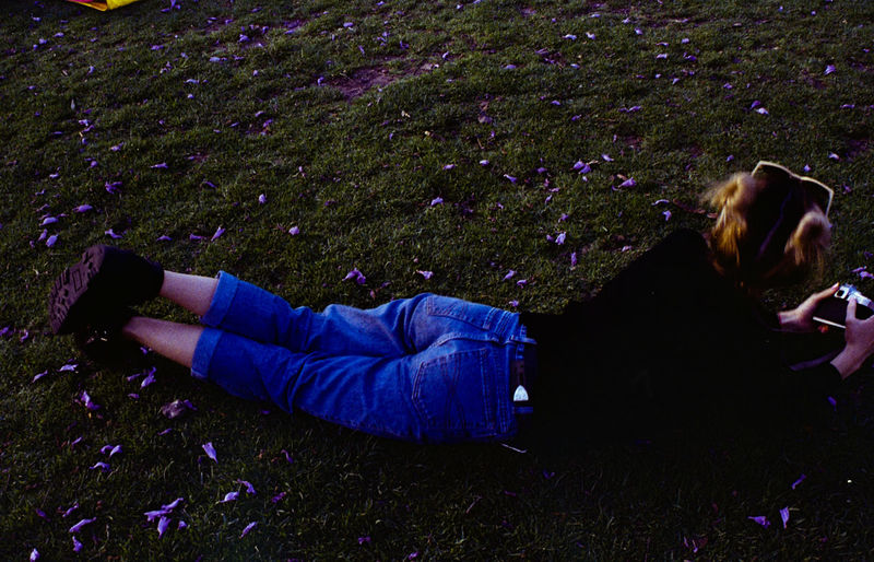 lying in the grass Lying On The Grass Lying Down Lying On Front Sunglasses Sunglasses On Hair Women Full Length Flower High Angle View Purple Grass