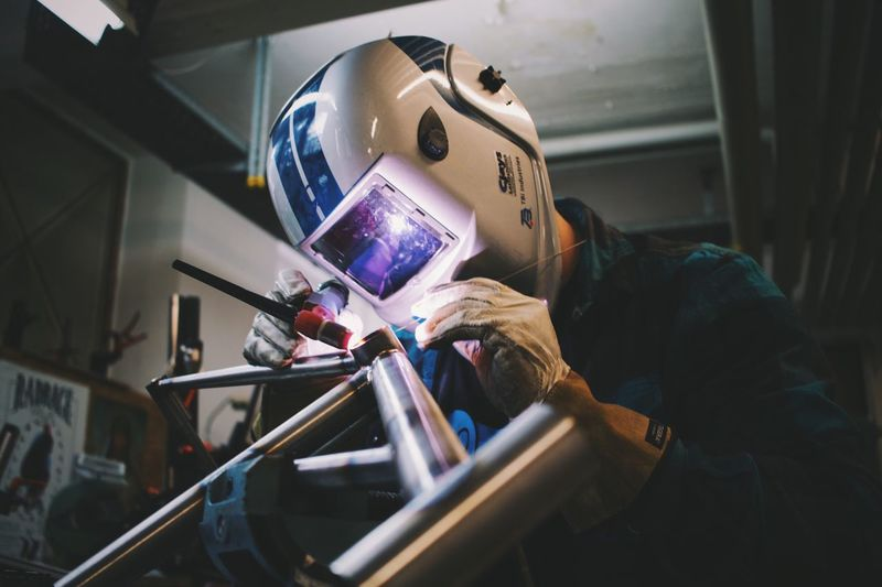 Close-up of worker working on factory
