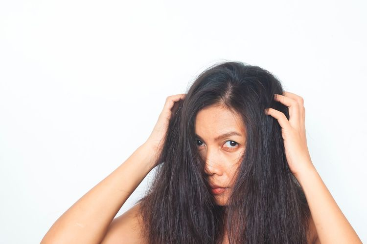 Middle aged Asian woman looking at camera worried about damaged hair. Healthy and beauty concept Advertising Advertisement Product Skincare Beauty Brown Hair Thai Woman Isolated Salon Fashion Photography Fashion Model Fashion Style Aging Asian Woman Asian  Human Hair Beautiful Woman Women Headshot Black Hair Lifestyles Hand In Hair Front View Copy Space Looking At Camera Hairstyle Indoors  Long Hair Young Women Portrait Hair One Person Young Adult White Background Studio Shot
