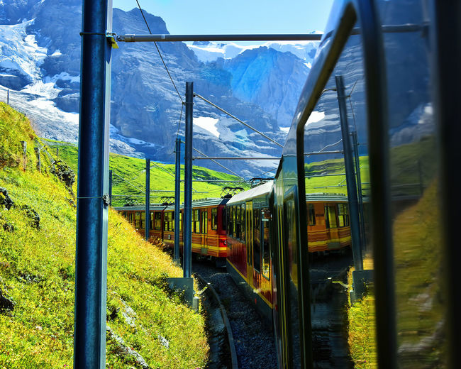 Train on railroad track by mountains