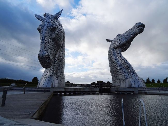 Sculpture Statue Sky Art And Craft Cloud - Sky Human Representation Low Angle View Built Structure Water Day No People Outdoors Architecture Nature Kelpies  Kelpies Of Falkirk