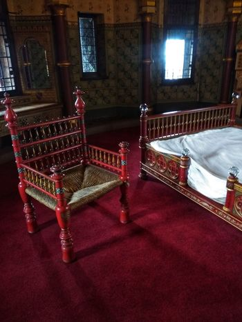 bedroom in a castle Bedroom 1877 Old Buildings Red Carpet Drapes  Curtain Chair Velvet Seat