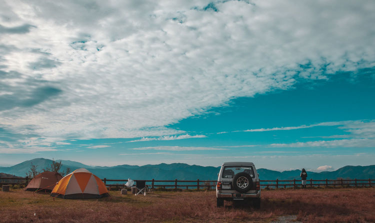 Camping Travel Adventure Beauty In Nature Camping Cloud - Sky Day Field Grass Landscape Mountain Nature No People Outdoors Scenics Shelter Sky Tent Tranquil Scene Tranquility Transportation Tree Vacations Vehicle Go Higher