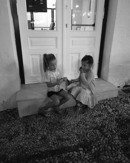 Sitting Togetherness Girls Childhood Child Young Women Streerphotography Door Playingtime Monochrome Cityphotography Greece