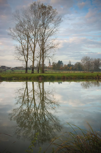 Water Reflection Tree Cloud - Sky Sky Lake Tranquility Plant Bare Tree Nature Beauty In Nature Tranquil Scene Scenics - Nature No People Waterfront Day Outdoors Symmetry Standing Water Reflection Lake Saône River Saône Et Loire Saone Burgundy Village French Village Church Sunrise