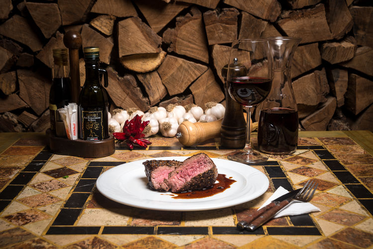 Beef Beef Steak Cooking Dinner Alcohol Beefsteak Bottle Cutting Board Day Drink Drinking Glass Food Food And Drink Freshness Indoors  Meat No People Plate Ready-to-eat Red Wine Restaurant Serving Dish Spice T-bone T-bone Steak Table Wine Wineglass