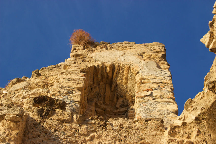 Castello Della Valle Arid Climate Beauty In Nature Blue Clear Sky Day Geology Low Angle View Nature No People Outdoors Physical Geography Rock - Object Rock Formation Sky Sunlight Tranquility
