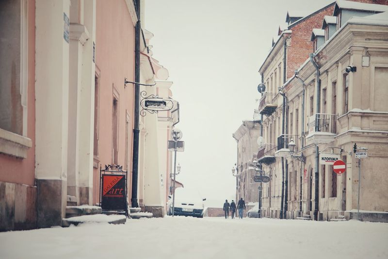 Winter Snow Cold Temperature Outdoors City Snowing Day Zamość Poland Old Architecture Ordinary Life Ordinary Day Atmospheric Mood Street Photography Winter Scene Urban Skyline Cityscape Architecture Building Exterior Built Structure