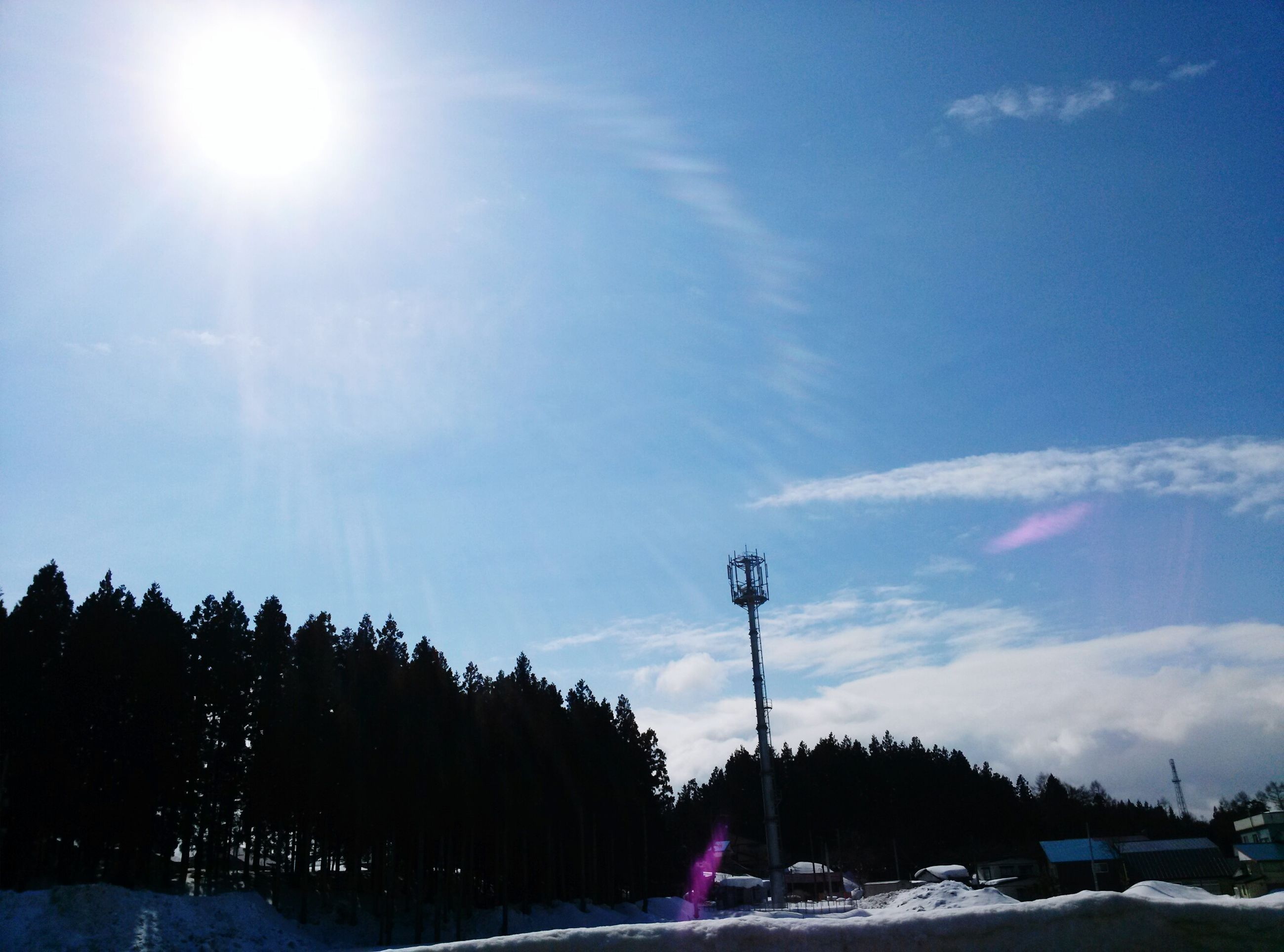 sun, sky, snow, sunbeam, cold temperature, winter, sunlight, lens flare, tranquility, beauty in nature, nature, tranquil scene, cloud - sky, street light, scenics, blue, transportation, road, season, weather