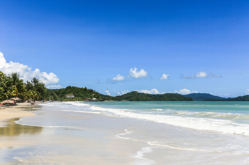 Pantai Cenang beach on the tropical island of Langkawi in Malaysia just south of the Thai border in the Andaman sea in Southeast Asia ASIA Beach Beauty In Nature Blue Cenang Cenang Beach Day Idyllic Island Landscape Langkawi Malaysia Nature No People Outdoors Sand Scenics Sea Sky Summer Tranquil Scene Tranquility Travel Water