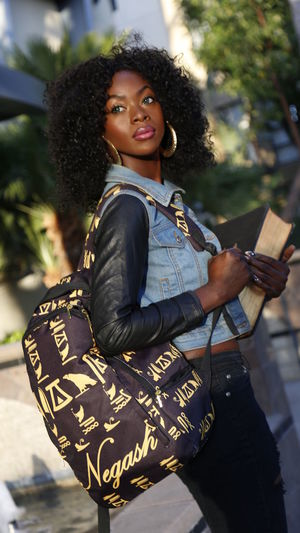 Black Woman Backpack Book College Girl  Curly Hair Day Happiness Jacket Lifestyles One Person Outdoors People Portrait Real People School Girl Standing Young Adult Young Women