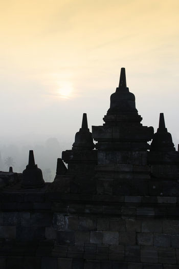 Silhouette Borobudur Temple with the mysteries forest surrounding during sunrise, Yogyakarta, Indonesia Ancient Borobudur Temple Java Yogyakarta Ancient Ancient Civilization Architecture Buddhism Building Exterior Built Structure Dawn Fog Forest History Mount Merapi No People Outdoors Place Of Worship Religion Religious Architecture Sky Spirituality Sunrise Sunset The Past