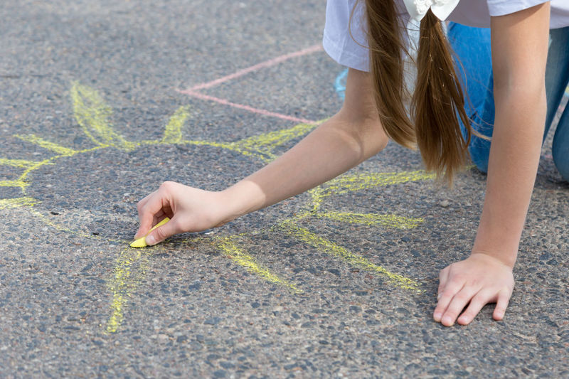 children draw in crayon on asphalt Happiness Sunshine Friendship Doodle Sketching Game Chalking Pavement Colorful Activity Creative Playground Happy Lifestyle Playing Coloring Painting Leisure Activity Leisure Education Artist Sun Cute Play People Image Draw Art Outside Street Sidewalk Closeup Close Up Hand Color Fun Outdoor Day Summer Crayons Children Family Chalk Drawing Asphalt Creativity Child Childhood Girl Copy Space