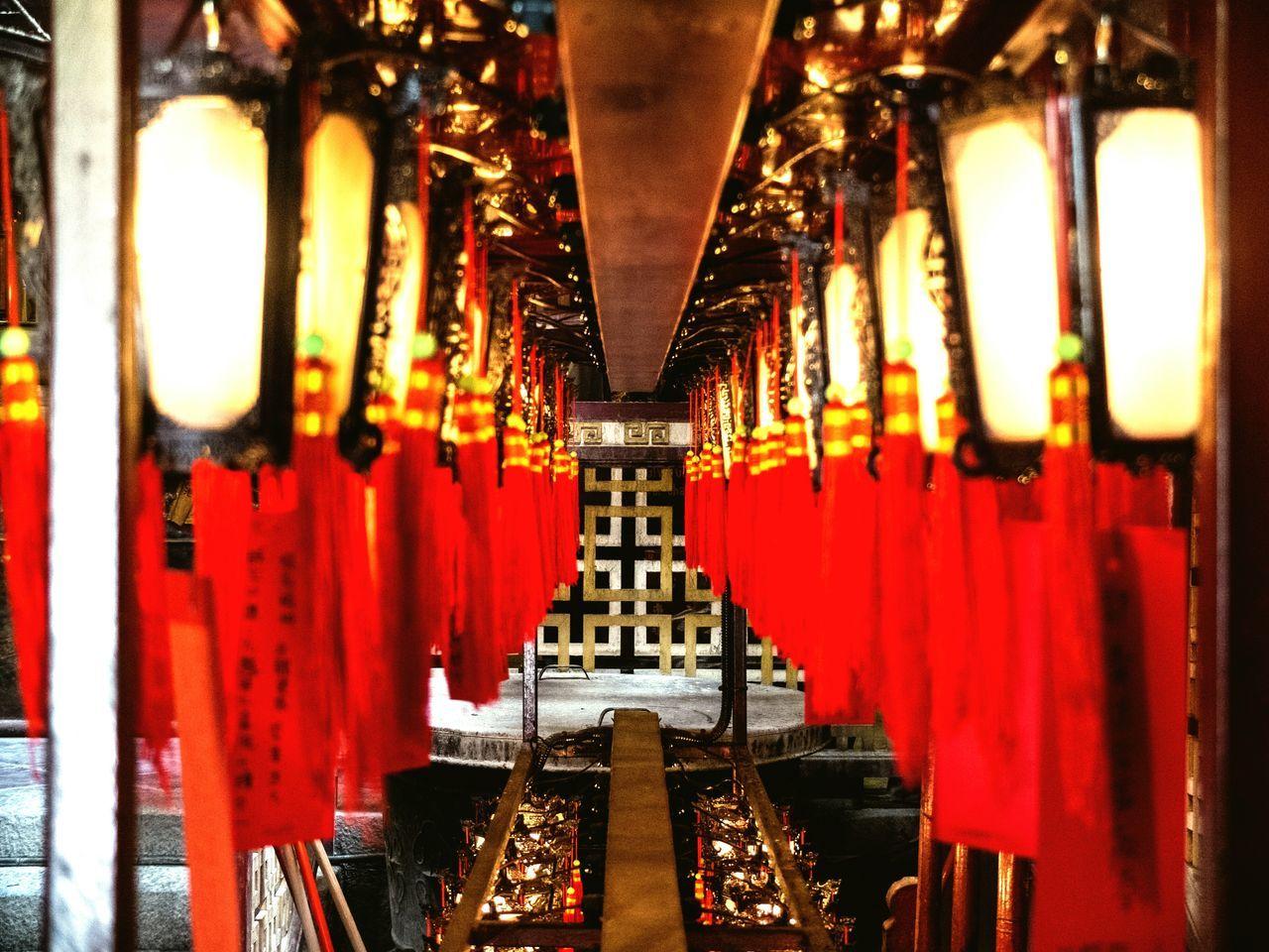 Close-Up Of Illuminated Chinese Lanterns Hanging In Man Mo Temple