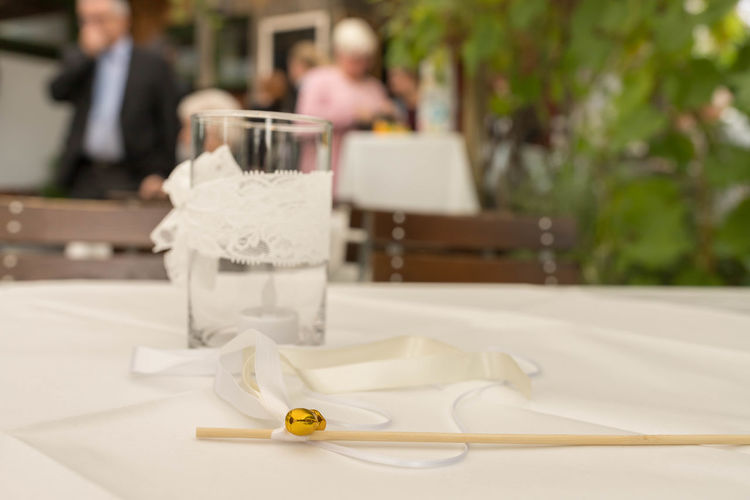 close-up of drink on table at restaurant August Business Candle Close-up Day Drink Drinking Glass Focus On Foreground Food And Drink Glass Household Equipment Incidental People Indoors  Paper Place Setting Refreshment Restaurant Setting Still Life Table Tray White Color
