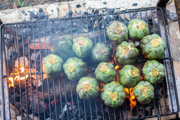 artichokes Food Healthy Eating Freshness Wellbeing No People Day Vegetable Fruit Outdoors Nature Large Group Of Objects Close-up Burning Market Green Color High Angle View Retail  Heat - Temperature Agriculture Artichoke