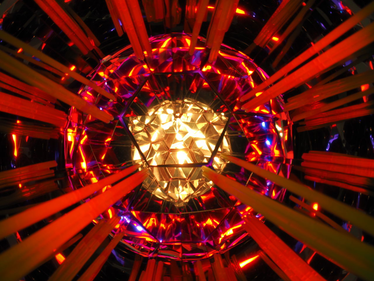 illuminated, lighting equipment, glowing, no people, night, low angle view, pattern, hanging, red, light, orange color, indoors, decoration, electricity, design, arts culture and entertainment, amusement park, electric light, amusement park ride, close-up, ceiling, directly below, electric lamp