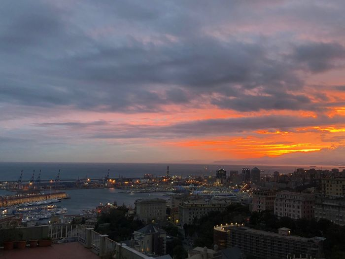 Sunset fro Castelletto area of Genoa Building Exterior Architecture City Sky Cityscape Built Structure Cloud - Sky Sunset Building Nature Orange Color Travel Destinations High Angle View Residential District No People Sea Dusk Dramatic Sky Outdoors